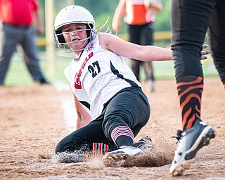 DIANNA OATRIDGE | THE VINDICATOR  Canfield's Leah Figueroa slides safely into home during their game against Howland in the 10U tournament in Boardman on Friday.