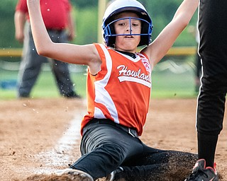 DIANNA OATRIDGE | THE VINDICATOR  Howland's Maya Kubancsek slides safely into home during their 10U tournament game versus Canfield in Boardman on Friday.