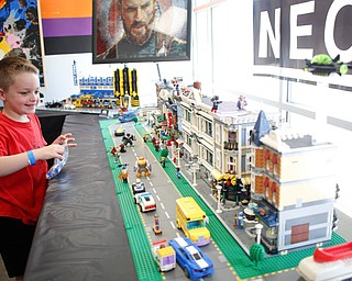 Grayson Hepburn, 5, of Noblesville, Indiana, looks at a Legos town made by members of NeoLUG, a group of adult hobbyists who share their passion for building with Legos, at the Youngstown Comic Con in Covelli Centre on Saturday afternoon. EMILY MATTHEWS | THE VINDICATOR