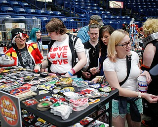 People look at various comic and cartoon-related patches at the Youngstown Comic Con in Covelli Centre on Saturday afternoon. EMILY MATTHEWS | THE VINDICATOR