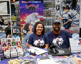 Vesenia Lindsey, the creator of the comic Celestial Pulse, poses for a photo with her husband Justin Lindsey at the Youngstown Comic Con in Covelli Centre on Saturday afternoon. EMILY MATTHEWS | THE VINDICATOR