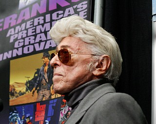 Jim Steranko, a graphic artist, stands behind his table where he was meeting and talking with fans at the Youngstown Comic Con in Covelli Centre on Saturday afternoon. EMILY MATTHEWS | THE VINDICATOR