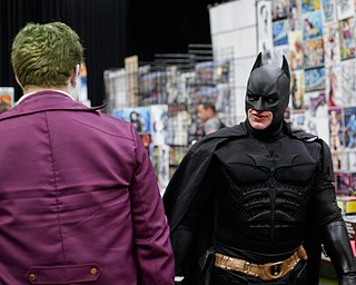 Dirk Granger, of Mineral Ridge, dressed as Batman, walks past another cosplayer dressed as the Joker at the Youngstown Comic Con in Covelli Centre on Saturday afternoon. EMILY MATTHEWS | THE VINDICATOR