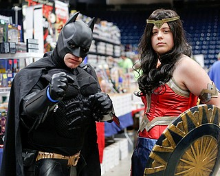 Dirk Granger, left, dressed as Batman, and his daughter Kya Granger, dressed as Wonder Woman, both of Mineral Ridge, pose for a photo at the Youngstown Comic Con in Covelli Centre on Saturday afternoon. EMILY MATTHEWS | THE VINDICATOR