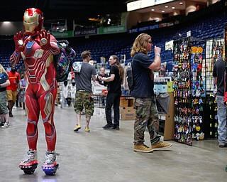 Tony Starr, of West Akron, dressed as Iron Man, poses for a photo at the Youngstown Comic Con in Covelli Centre on Saturday afternoon. EMILY MATTHEWS | THE VINDICATOR