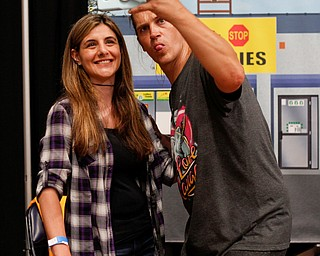 Tace Zona, left, of New Castle, takes a photo with Jason Mewes at the Youngstown Comic Con in Covelli Centre on Saturday afternoon. EMILY MATTHEWS | THE VINDICATOR