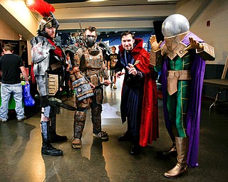 From left, Brennan Lowmaster, dressed as Centurion, Shane Pieplow, dressed as Ralo from Fallout, Caleb Pieplow, dress as Dr. Strange, and Carl Sopkovich, dressed as Mysterio, pose for a photo at the Youngstown Comic Con in Covelli Centre on Saturday afternoon. EMILY MATTHEWS | THE VINDICATOR