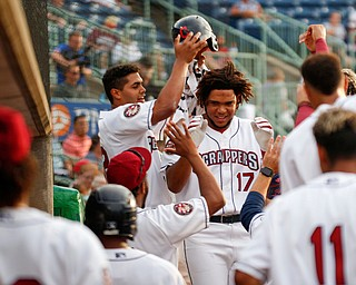 Scrappers' Henderson De Oleo (17) celebrates with his teammates after hitting a home run against the Spikes at Eastwood Field on Saturday night. EMILY MATTHEWS | THE VINDICATOR