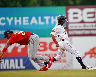 Scrappers' Brayan Rocchio gets back to second before the Spikes' Moises Castillo could tag him during their game at Eastwood Field on Saturday night. EMILY MATTHEWS | THE VINDICATOR