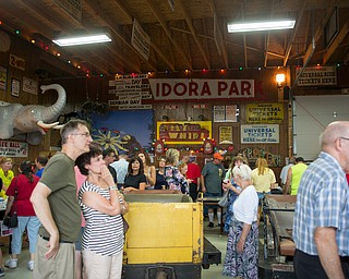 People check out various park memorabilia from rides to signs at the Idora Park experience on Sunday. EMILY MATTHEWS | THE VINDICATOR
