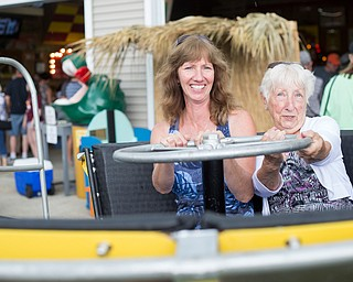 Alice Swarts, left, and Mary Ann Holland, both of Alliance, sit in a replica of the turtle ride at the Idora Park experience on Sunday. EMILY MATTHEWS | THE VINDICATOR