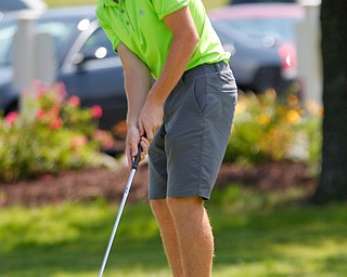 Kaiden Sykes, 15, of South Range, putts the ball during the Greatest Golfer junior qualifier at Salem Hills Golf Club on Tuesday. EMILY MATTHEWS | THE VINDICATOR