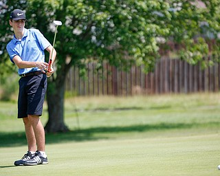 Ethan Sicafuse, 17, of Ursuline watches the ball after he putts it during the Greatest Golfer junior qualifier at Salem Hills Golf Club on Tuesday. EMILY MATTHEWS   THE VINDICATOR