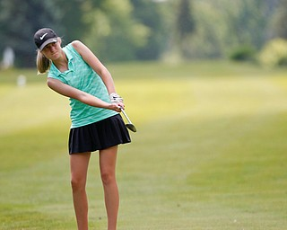 Mckenzie Gustus, 14, of Hermitage, hits the ball during the Greatest Golfer junior qualifier at Salem Hills Golf Club on Tuesday. EMILY MATTHEWS   THE VINDICATOR