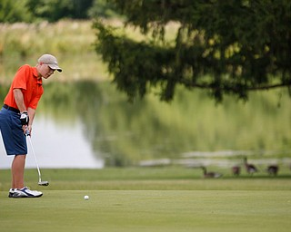 Anthony Cesario, 13, of Niles, putts the ball during the Greatest Golfer junior qualifier at Salem Hills Golf Club on Tuesday. EMILY MATTHEWS | THE VINDICATOR
