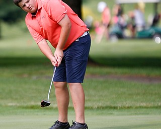Nathan Kelly, of East Liverpool, putts the ball during the 14u Greatest Golfer junior qualifier at Tam O'Shanter Golf Course in Hermitage, Pa. on Thursday. EMILY MATTHEWS | THE VINDICATOR