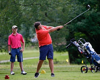 Nathan Kelly, right, of East Liverpool, drives the ball while Anthony Cesario, of Niles, watches during the 14u Greatest Golfer junior qualifier at Tam O'Shanter Golf Course in Hermitage, Pa. on Thursday. EMILY MATTHEWS | THE VINDICATOR