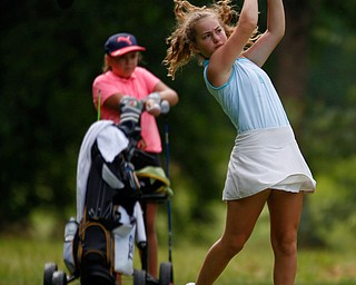 Luciana Masters, 12, of Hermitage, drives the ball while Kate Sowers, 11, of West Middlesex, watches during the Greatest Golfer junior qualifier at Tam O'Shanter Golf Course in Hermitage, Pa. on Thursday. EMILY MATTHEWS | THE VINDICATOR