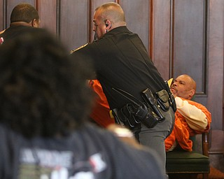 ROBERT K.YOSAY  | THE VINDICATOR..Mahoning County deputies had to stun a man and arrested two people after they attacked a man who was to be sentenced in common pleas court for killing a woman in June 2017...A son of Elizabeth Stewart and another man attacked Dale Williams, 46, jumping over a table and grabbing Williams and punching him.