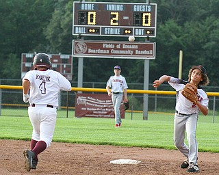 William D. Leiws The vindicator  Canfield's Jake Bednar(2) makes the throw to first for a double play as Boardman's Tyler Kirlik (4) is out at 2nd.