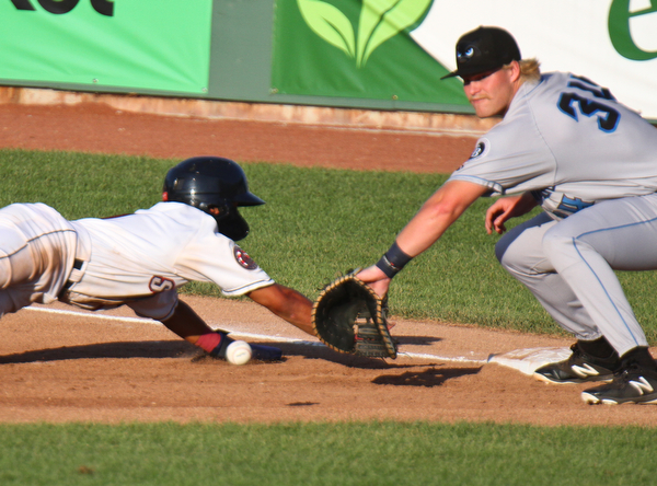 William D. Leiws The Vindicator  Scrappers Brayan Roccio(1) dives back to first as Renegades Jacson McGowan(34) waits for the throw during 71-15-19 action at Eastwood.