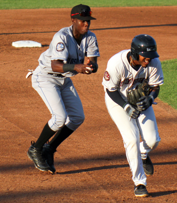 William D. Lewis The Vindicator Scrappers Eric Rodriguez(10) is tgged by Renegades 3rd baseman Luis Arcendo(13).