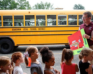 Ryan Dunn, Boardman's Transportation Supervisor, talks to incoming kindergarteners about bus safety as part of United Way's Success By 6 program at Stadium Drive Elementary on Tuesday morning. EMILY MATTHEWS | THE VINDICATOR