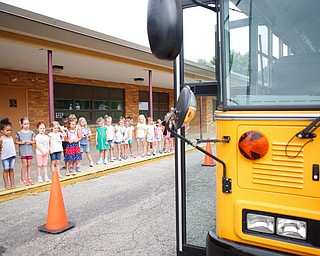 Incoming kindergarteners look at a school bus as they learn about bus safety as part of United Way's Success By 6 program at Stadium Drive Elementary on Tuesday morning. EMILY MATTHEWS | THE VINDICATOR