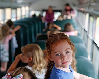 Ellie Liebig, an incoming kindergartener, sits on a school bus as part of United Way's Success By 6 program's bus safety day at Stadium Drive Elementary on Tuesday morning. EMILY MATTHEWS | THE VINDICATOR