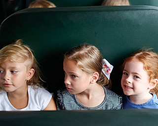 From left, incoming kindergarteners Alice Schumaker, Bexley Jamieson, and Ellie Liebig sit on a school bus as part of United Way's Success By 6 program's bus safety day at Stadium Drive Elementary on Tuesday morning. EMILY MATTHEWS | THE VINDICATOR