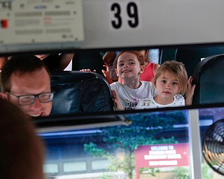Incoming kindergarteners Alexandria Volsho, right, and Eliza Liebig look at themselves in the rearview mirror as they get off the bus and Ryan Dunn, Boardman's Transportation Supervisor, sits in the drivers seat as part of United Way's Success By 6 program's bus safety day at Stadium Drive Elementary on Tuesday morning. EMILY MATTHEWS | THE VINDICATOR