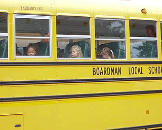 Incoming kindergarteners sit on a school bus as part of United Way's Success By 6 program's bus safety day at Stadium Drive Elementary on Tuesday morning. EMILY MATTHEWS | THE VINDICATOR