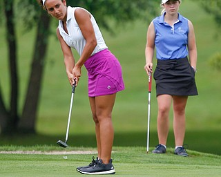 Carly Ungaro, left, putts the ball while Sophia Yurich watches in the U-17 Greatest Golfer Juniors finals at Squaw Creek Golf Course in Vienna on Friday. EMILY MATTHEWS | THE VINDICATOR