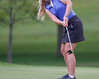Sophia Yurich putts the ball in the U-17 Greatest Golfer Juniors finals at Squaw Creek Golf Course in Vienna on Friday. EMILY MATTHEWS | THE VINDICATOR