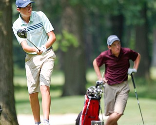 Michael Porter, left, and Kaiden Sykes watch Porter's drive in the U-17 Greatest Golfer Juniors finals at Squaw Creek Golf Course in Vienna on Friday. EMILY MATTHEWS | THE VINDICATOR