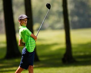 Matthew Morelli watches his drive during the Greatest Golfer Boys U14 championship at Avalon Lakes on Saturday. EMILY MATTHEWS   THE VINDICATOR