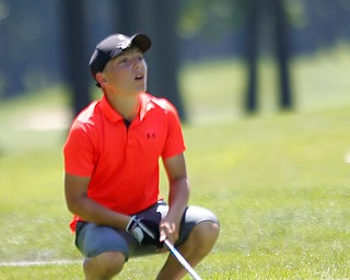 Anthony Cesario reacts as he watches his drive during the Greatest Golfer Boys U14 championship at Avalon Lakes on Saturday. EMILY MATTHEWS   THE VINDICATOR
