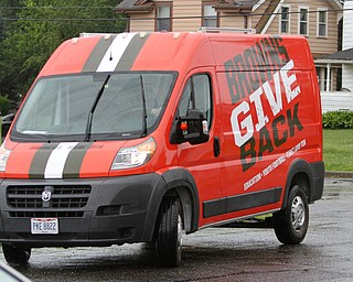 ROBERT K.YOSAY  | THE VINDICATOR..Cleveland Browns officials visited...Chaney High School - girard.. and one other school to make a donation to the CowboysÕ football and ..Browns Give Back Van.. complete in browns color