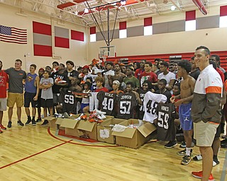 ROBERT K.YOSAY  | THE VINDICATOR..Cleveland Browns officials visited...Chaney High School - girard.. and one other school to make a donation to the CowboysÕ football and