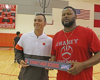 ROBERT K.YOSAY  | THE VINDICATOR..Cleveland Browns officials visited...Chaney High School - girard.. and one other school to make a donation to the CowboysÕ football and ..Adam Weber and Chris Amil CHaney Coach and the NFL 100..