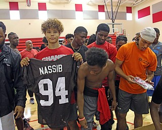 ROBERT K.YOSAY  | THE VINDICATOR..Cleveland Browns officials visited...Chaney High School - girard.. and one other school to make a donation to the CowboysÕ football and ..Christian Jones.. sophomore.. checks out a jersey