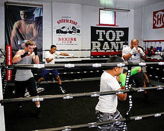 Members of Jack Loew's South Side Boxing Club shadowbox at the club on Erie Street on Monday. EMILY MATTHEWS | THE VINDICATOR