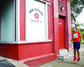Juan Jauregui, 10, a member of Jack Loew's South Side Boxing Club, jumps rope outside the club on Erie Street on Monday. EMILY MATTHEWS | THE VINDICATOR