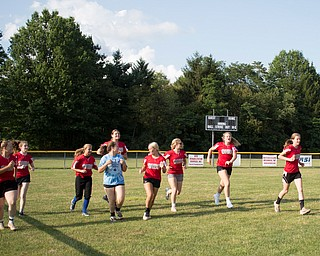 The Canfield-Poland softball team, who will be playing in the Junior League Softball World Series in Washington on Sunday, run at the beginning of practice at McCune Park on Wednesday. EMILY MATTHEWS   THE VINDICATOR