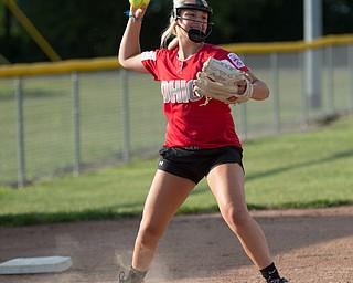 Lainey Bednar throws the ball to first as she practices with her Canfield-Poland softball team, who will be playing in the Junior League Softball World Series in Washington on Sunday. EMILY MATTHEWS   THE VINDICATOR