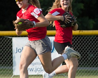 Alaina Scavina fields the ball while Alaina Frances runs behind her to back her up as they practice with their Canfield-Poland softball team, who will be playing in the Junior League Softball World Series in Washington on Sunday. EMILY MATTHEWS   THE VINDICATOR