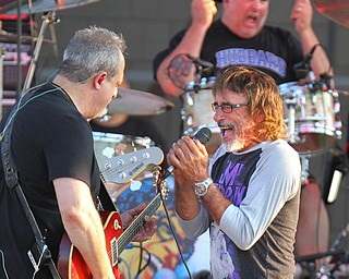 William D. Lewis The Vindicator   Donnie Iris, right,performs during concert 7-28-19 at Youngstown Amphitheater.