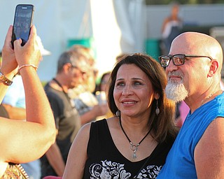 William D. Lewis The Vindicator Zina and Mike Iacobucci of Boardman pose for a photo near the stage during Donnie Iris Michael Stanley concert 7-28-19 at Youngstown Amphitheater.