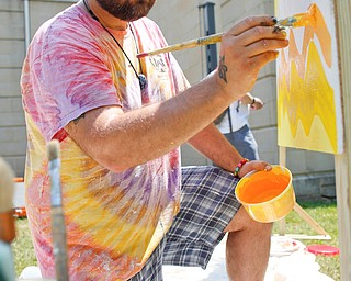 James Shuttic, of Warren, paints at the Warren Walk Against Heroin at the Warren Amphitheater on Sunday. EMILY MATTHEWS | THE VINDICATOR