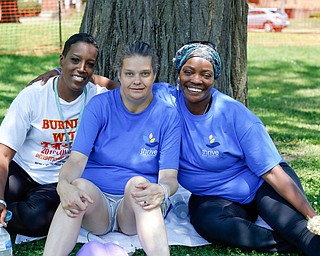 From left, Shakinah Mathers, of Warren, Tasha Dore, of Cleveland, and Gail Cox, of Cleveland, pose for a photo at the Warren Walk Against Heroin at the Warren Amphitheater on Sunday. EMILY MATTHEWS | THE VINDICATOR